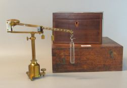 Gilded brass Westphal scientific balance with weights and accessories in a fitted wooden box.