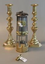 Pair of brass baluster candlesticks, 32 cm high approx. Together with a small cylindrical brass