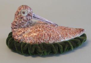 Ceramic egg crock cover in the form of a woodcock on a velvet base. (B.P. 21% + VAT)