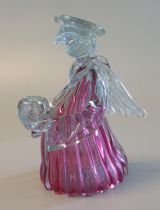 Novelty cranberry and clear art class candle holder in the form of an angel. (B.P. 21% + VAT)