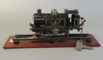Hornby 0 gauge tin plate clockwork LNS no623 040 tank locomotive on section of display track with