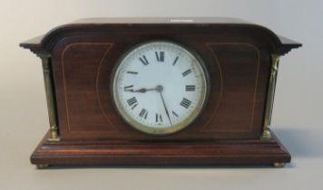 Edwardian inlaid mahogany architectural flat-topped mantel clock with brass pillars and circular