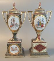 Pair of Continental, probably Austrian, porcelain urn-shaped, two-handled lidded vases. Panels are