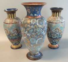 Pair of Doulton Lambeth stoneware baluster vases, hand painted with flowers and foliage together