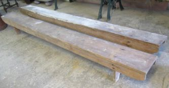 Two similar early 20th century rustic benches of low proportions. 260 x 31 cm approx. (2) (B.P.