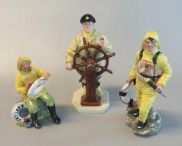 Three Royal Doulton china marine figures 'The Boatman' HN2417, 'The Helmsman' HN2499, and 'The
