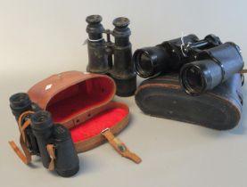 Pair of Regent 7x50 binoculars in leather case, pair of Seeker S.T.C 8x30 binoculars in pig skin