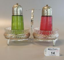 A pair of mid Century glass sugar sifters, one in cranberry glass, the other in green glass, mounted