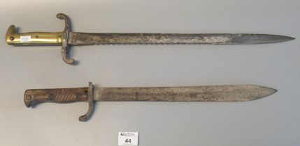 British First World War period sword bayonet and another brass hilted saw backed bayonet. (2) (B.