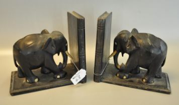 Pair of ebonised bookends in the form of elephants. (B.P. 21% + VAT)
