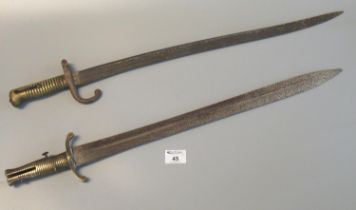 19th Century sword bayonet with brass hilt and cross guard, together with another probably French