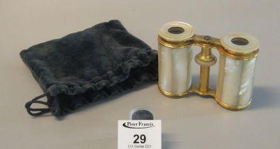 Pair of mother of pearl and gilt metal opera glasses marked Bassett, Fleet Street, London. Velvet