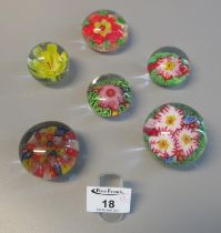 Collection of six French floral glass paperweights (one caned in the style of Clichy). (B.P. 21% +