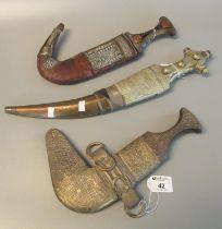 Three Arab type Jambiya daggers with white metal mounts. (3) (B.P. 21% + VAT) These items cannot