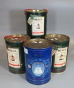 Three Bell's old Scotch whisky extra special decanters in tubular boxes with rope handles to
