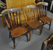 Set of three elm and beech slat back kitchen chairs on moulded seats and turned legs. (3) (B.P.