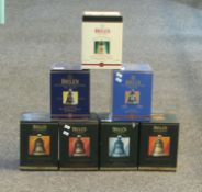 Seven Bell's old Scotch whisky porcelain decanters all in original boxes to include; Christmas '93 &