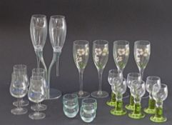 Champagne flutes and other glasses.