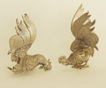 Silver plated fighting cocks / roosters.