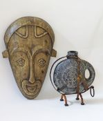 Wooden mask and a ceramic vase