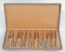 Silver desert knives and forks.