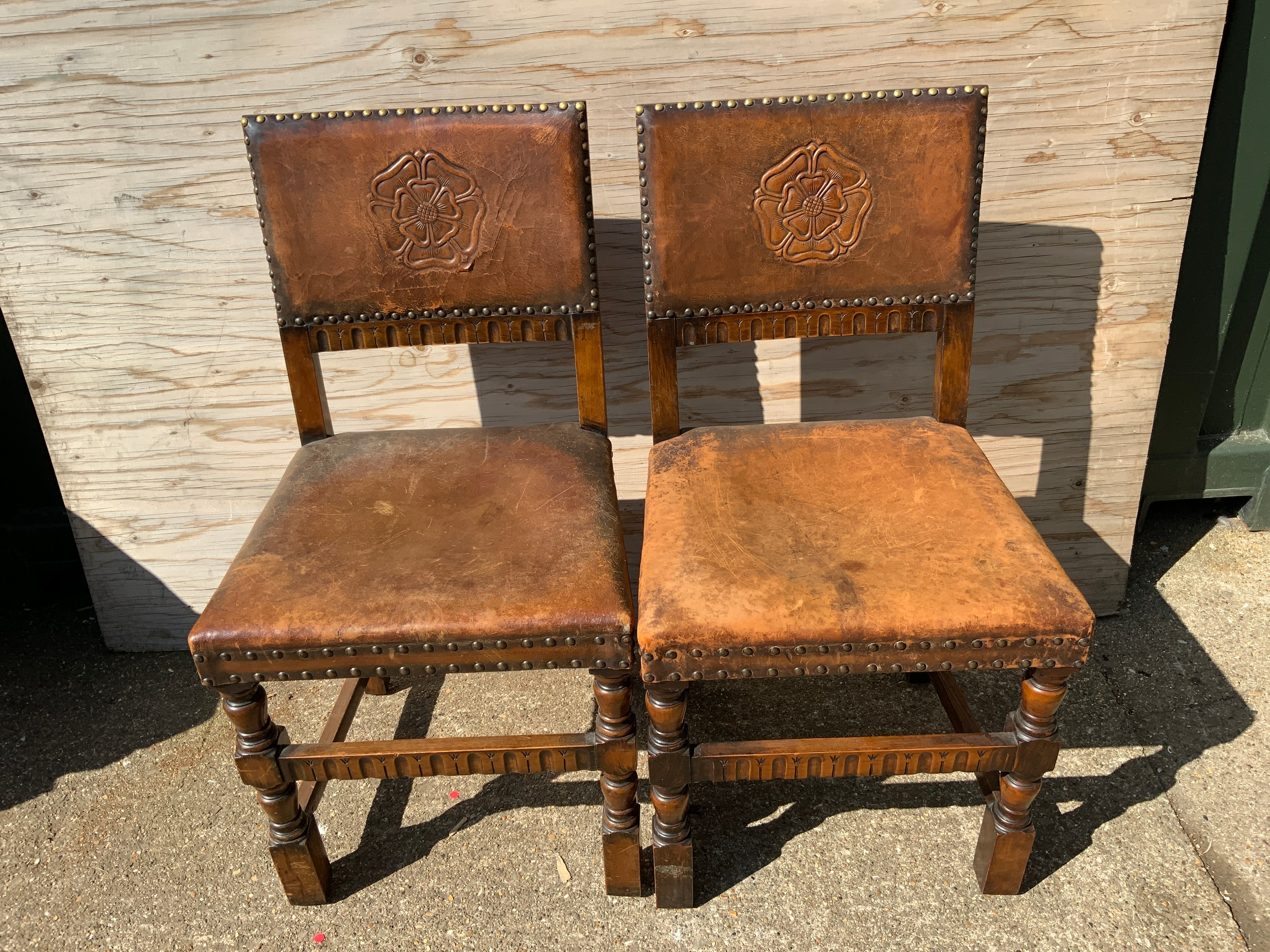 Pair of Oak Leather Covered Roseback Brass Studded Chairs