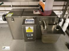 Guardian automatic Grease Removal Unit (located in Kitchen)