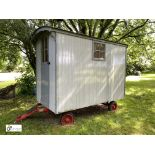 Timber Shepherds Hut, on steerable chassis with stable door, 2 windows, bunkbed, cupboard, miniature