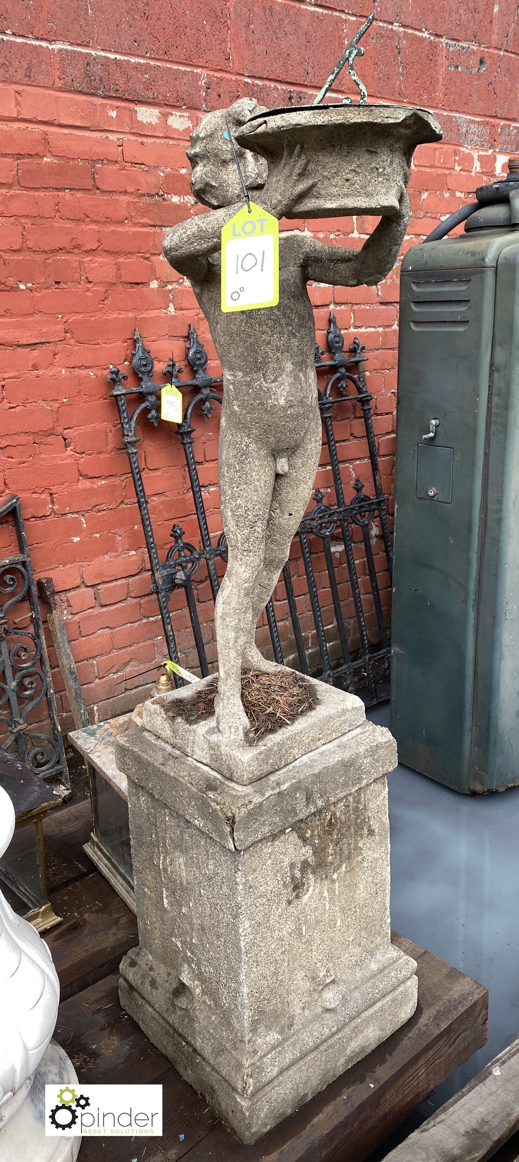 Stone Figure of young boy holding sundial, 890mm tall, on stone base, 540mm tall x 315mm x 315mm,