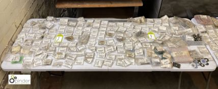 Large quantity of unused Komori spare parts inc. pins, knobs, washers, feeder tape, brackets,