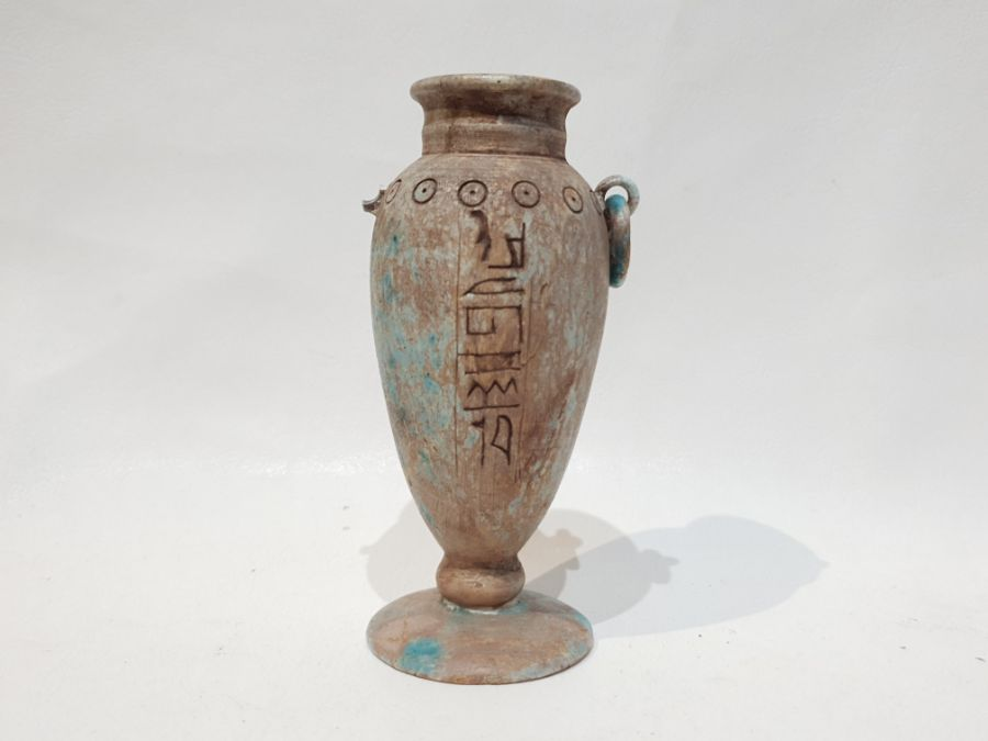 A Marble Vase with Egyptian Hieroglyphics inscribed on it.