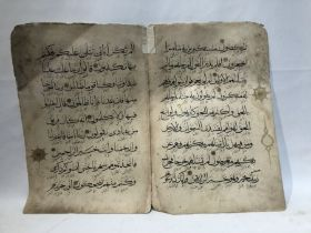 2 Folios of the Al-Yakhani Qur'an 14th Century Written in black and Decorated with Gold on its Edges