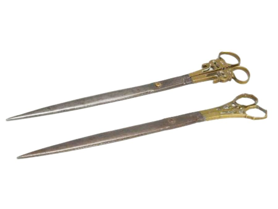 A pair of Middle Eastern Islamic steel and brass calligraphy scissors