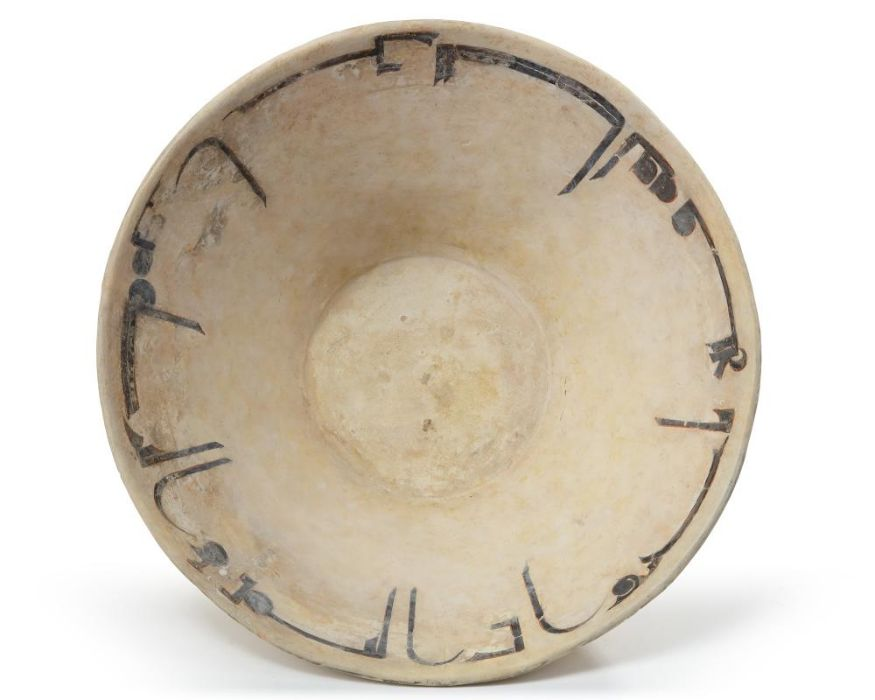 A NISHAPUR CALLIGRAPHIC SLIP-PAINTED POTTERY BOWL, PERSIA, 10TH CENTURY