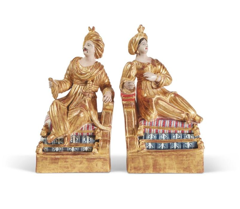 A pair of late 19th Century Parcel Gilt & Polychrome painted terracotta of books holders 30cm tall x