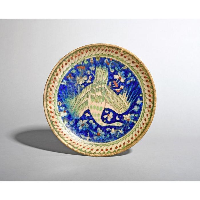 An Islamic pottery dish 19th century or earlier