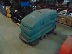 WALK BEHIND FLOOR SCRUBBER, TENNANT MDL. 5700XP, battery pwrd. (out of service)