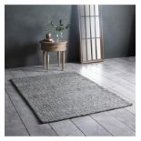 Arizona Rug Stone/Teal Add the finishing touch to your home with this beautiful rug. The rug has a