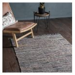 Alonzo Rug Multi This statement hand loomed rug is crafted using re-cycled materials in a striking