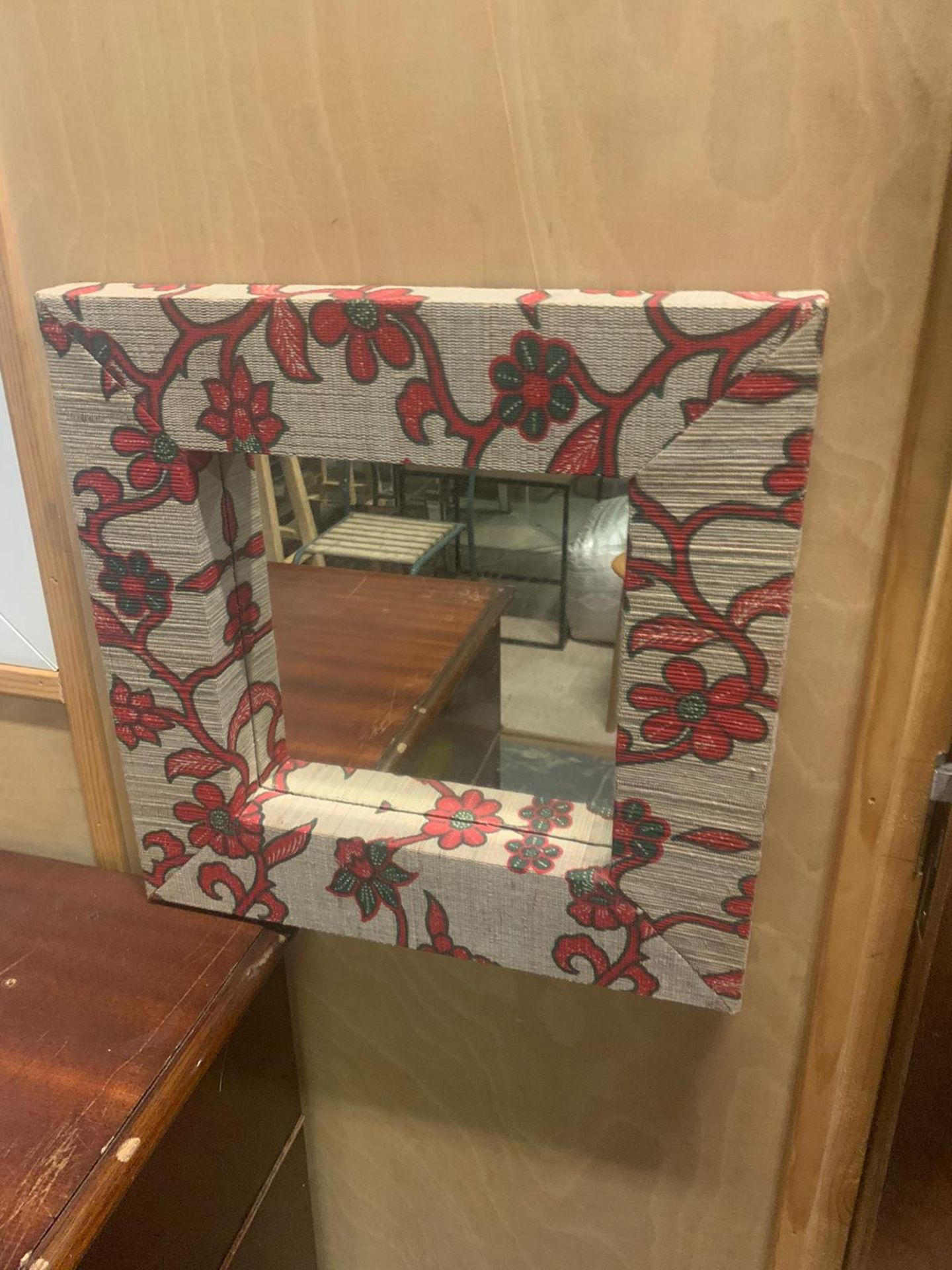 A pair of small woven read framed accent mirrors