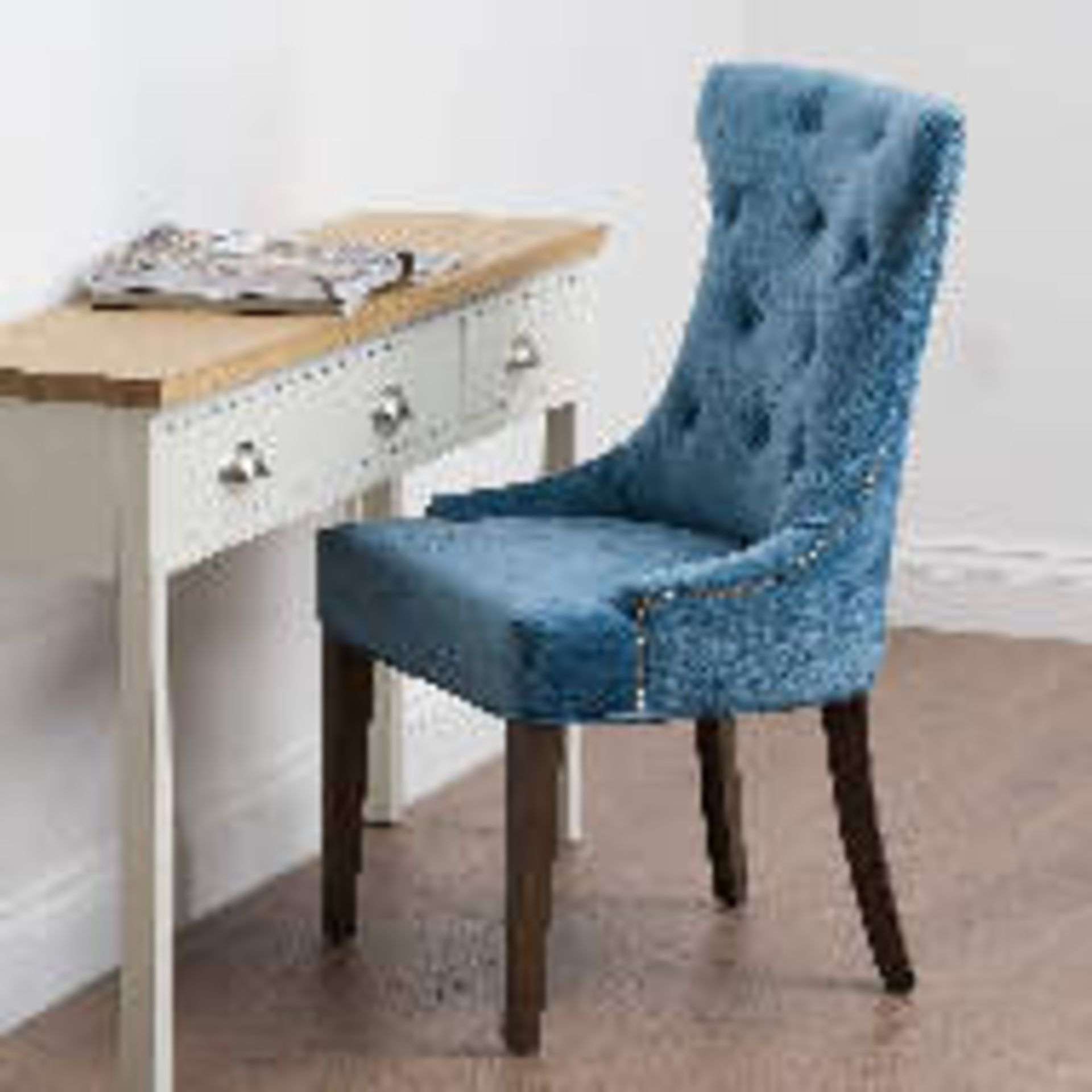 A pair of Teal Wing Chair Button Pressed Cocktail Wing Chair, made in a chenille material and