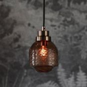 Thorson Pendant Light Modern pendant light featuring metal fixtures and a tinted and textured