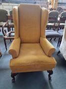 Arthur Brett Mahogany Wing Chair Bespoke Yellow Upholstery Hand-Carved Mahogany Wing Chair Of