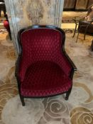 A Red Upholstered Lounge Chair With Mahogany Arms And Studied Back 68x 60x 91cm