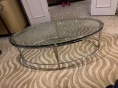A polsihed Nickel Oval Coffee Table Glass Top 120 X 61 X 41cm