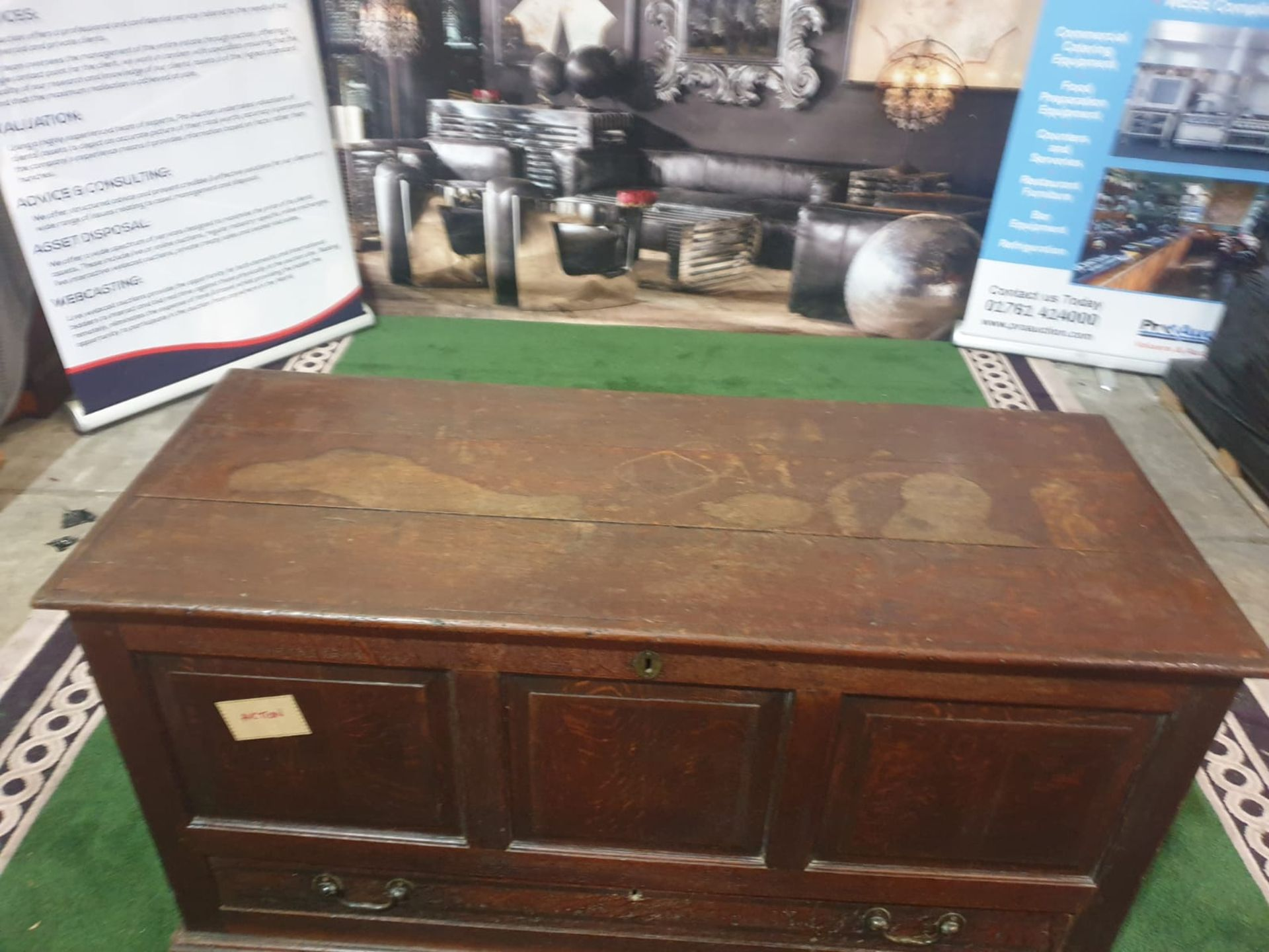 A George III oak `mule` chest. The planked hinged lid above a triple panel front and lower - Image 3 of 7