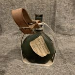 A French cast white metal Armagnac bottle holder, made for Armagnac Ducastaing in the form of a
