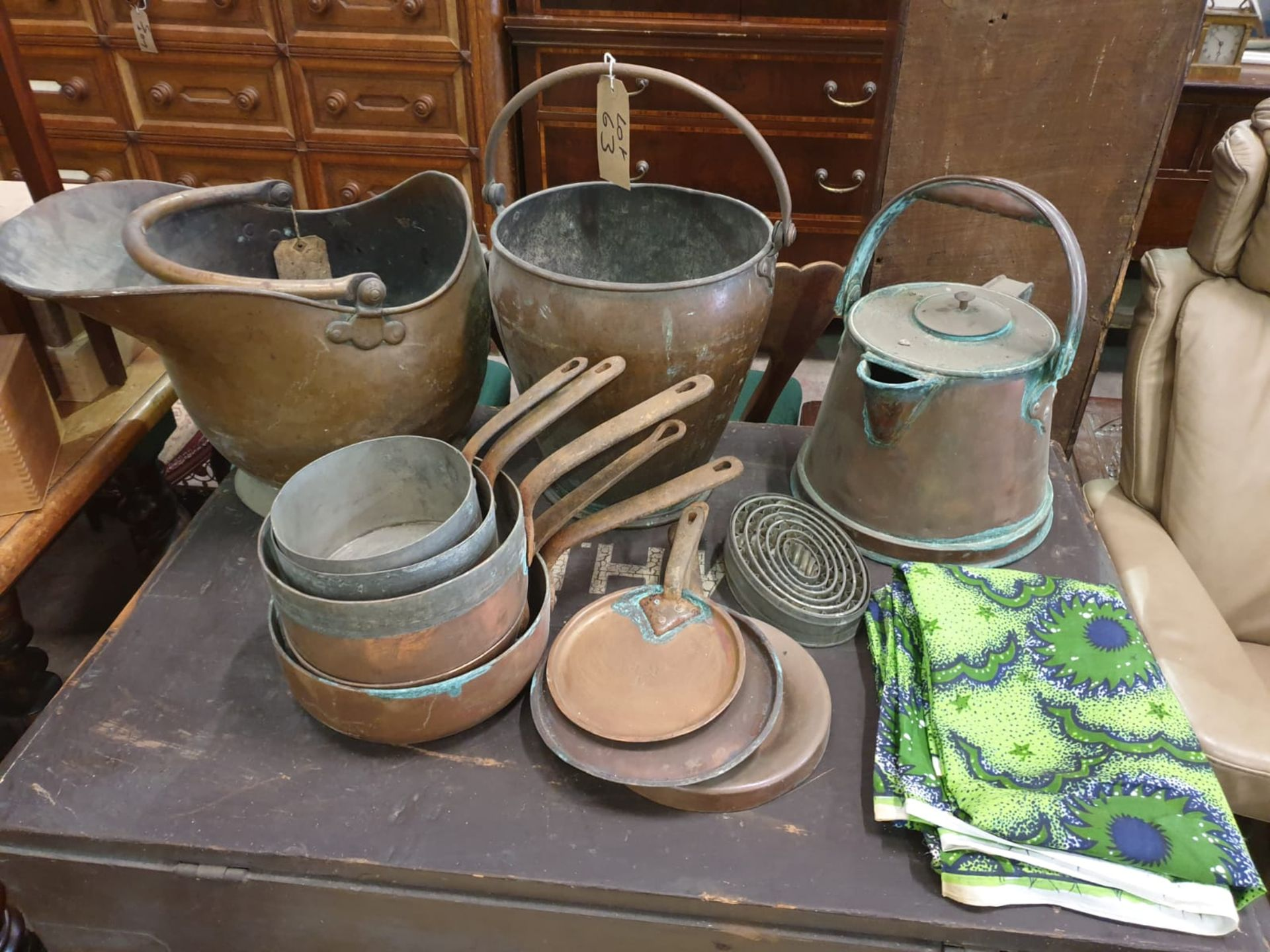 A large quantity of copperwear as found comprising bucket, pale, kettle, pans and skillets