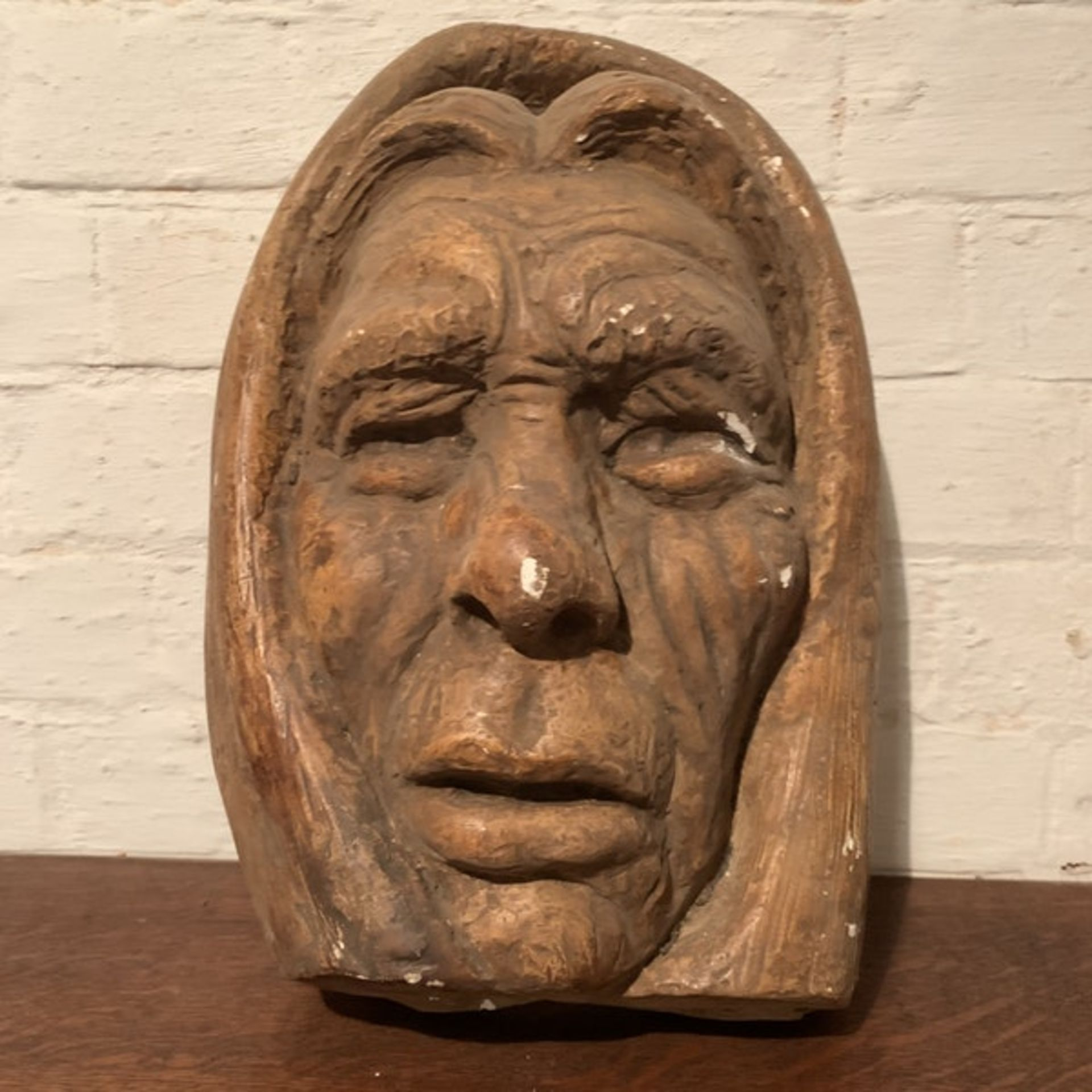 A well executed plaster sculpture of a mans face, not attributed to any artist