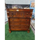 A Victorian mahogany chest. The oblong top above a flush frieze and a panelled hat drawer flanked by